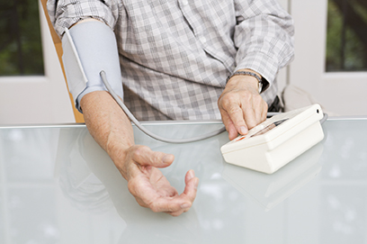 Man checking his blood pressure with machine