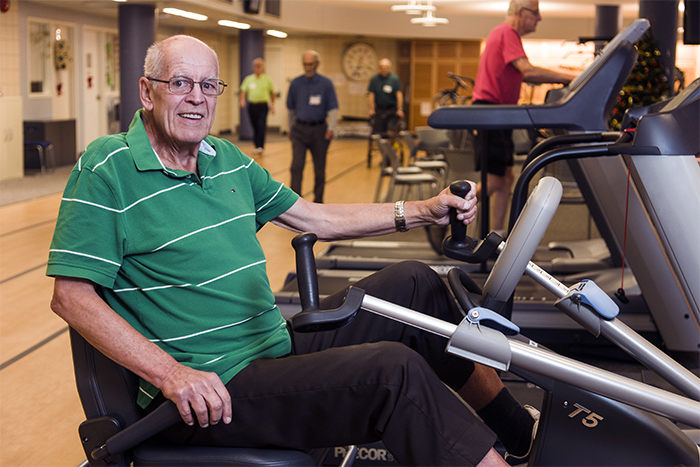 Male participant on the exercise bike at the Heart Institutes rehab track