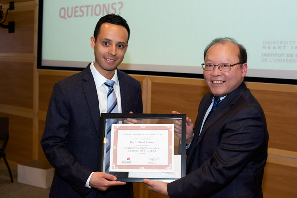 Dr. F. Daniel Ramirez received the Trainee of the Year Award from Dr. Peter Liu, Chief Scientific Officer, UOHI