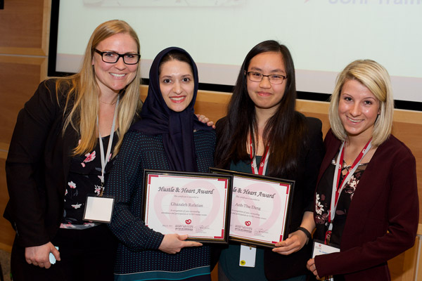 Centre left: Ms. Ghazaleh Rafatian (Davis lab) and centre right: Ms. Anh-Thu Dang (McPherson lab) received the Hustle and Heart Award for Significant Contributions to the Work in Progress Rounds. Far left: Dr. Lisa Cotie (Reid group), Co-Chair, Trainee Committee and far right: Ms. Sandrine Parent (Davis lab), Work in Progress Rounds Coordinator.