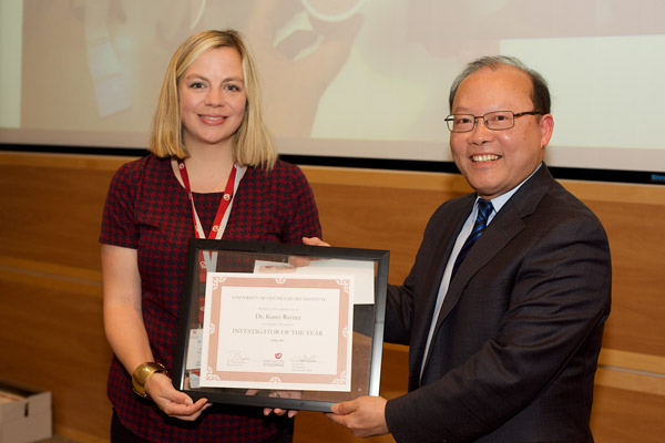 Dr. Katey Rayner (left) received the Investigator of the Year Award at Research Day from Dr. Peter Liu, Chief Scientific Officer, UOHI