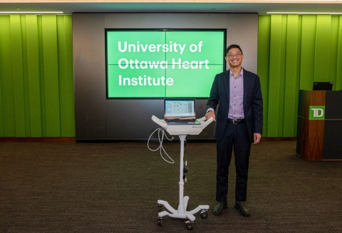 Dr. Benjamin Chow poses with a CAD-det test unit.