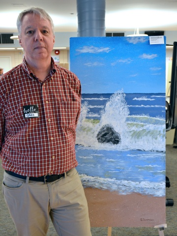 """Artist Greg Beamish's """"Weathering the Tide"""" is inspired by the real beauty of the Canary Islands, he said. Greg said he has always found comfort in the soothing sound of rolling waves. He hopes his painting will bring this to Heart Institute patients. Look closely: Greg has hidden a Heart Institute swirl amidst the waves to give this scene a calming touch."""