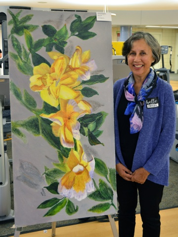 """""""To me, flowers are a miracle of nature, a miracle of life,"""" said Manju Sah, pictured here beside her painting, """"Joie de vivre."""" Manju hopes her painting will bring peace and healing to those who need it, """"just as real flowers do."""""""
