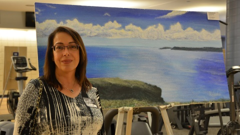 """This painting of Signal Hill in St. John's Newfoundland is painted by Nahid Shukralla, seen here. Nahid said the work brings back pleasant memories of a family trip to the east coast. """"When I think of calm, this is what I think about."""""""