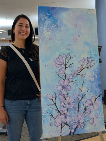 """Look closely. Hidden in the branches in """"Blossoms in May,"""" Steffi Acevedo placed a tiny four-legged friend. Steffi is a ceramic artist based in Ottawa and says watercolours and acrylics are her favourite mediums. She says """"a breath of fresh air"""" was the inspiration behind this painting. (Hint: the four-legged friend is a tiny dachshund.)"""