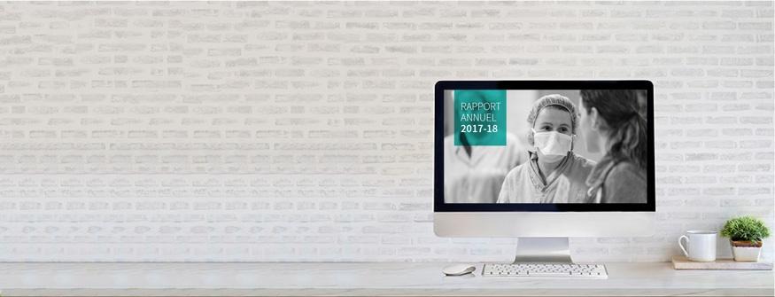 Un écran d'ordinateur affiche les visuels du rapport annuel