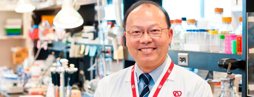 Dr. Peter Liu posing in a laboratory