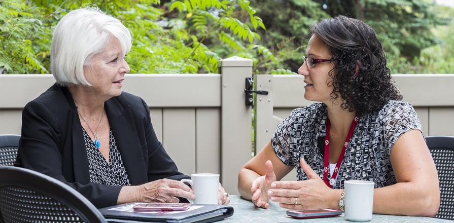 Roxy Hamilton (left), a group leader, talks with Women@Heart Program Lead Nadine Elias about how important it is for participants to share their thoughts and feelings with other women who have heart disease.