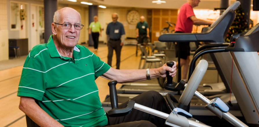 Cardiac rehabilitation patient on a stationary bicycle