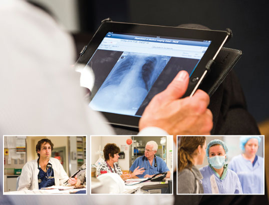 A health worker looking at a digital X-Ray on a tablet